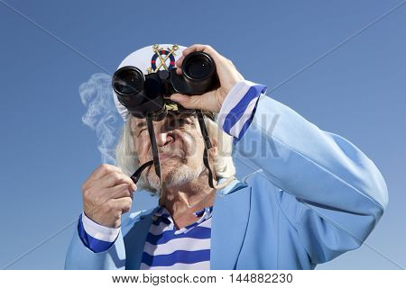 Captain looks through a binoculars