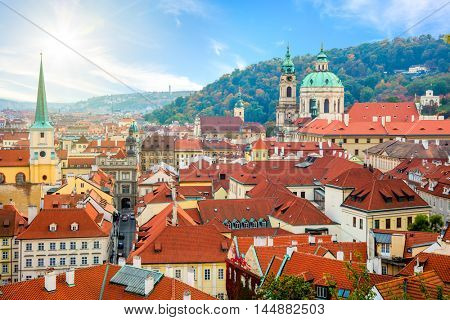 Aerial view of Red Tiles roofs in the city Prague, Czech Republic, European travel. Beautiful Autumn day with blue sky with clouds in the town.