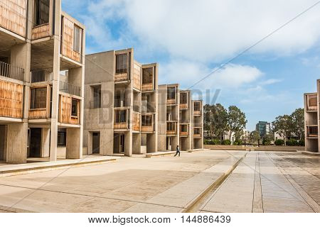 La Jolla, USA - December 10, 2015: Cement modern urban architecture of the Salk Institute in San Diego with person exercising