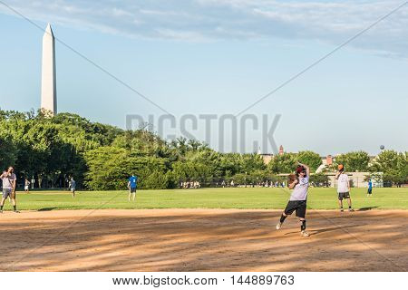 Washington, DC., USA - August 4, 2016: Happy smiling people playing baseball on the National Mall