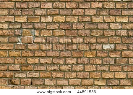 Old red brick wall fragment background texture. Close up