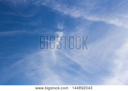 Blue sky background with white tiny clouds