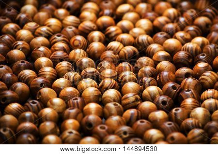 Wooden beads background. Wooden beads background background