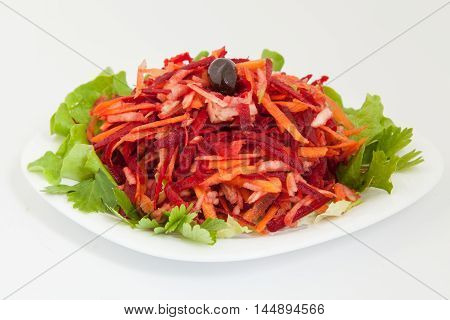 salad of fresh beets and carrots in white plate