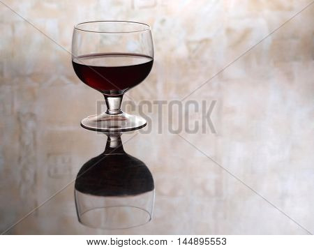 Glass with cognac on wood table