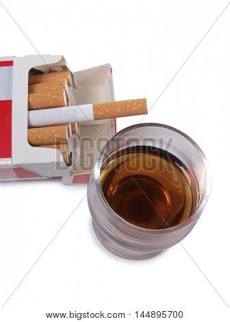 Cigarettes and glass of wine on white background