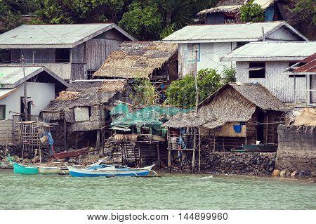 BUKANA, PHILIPPINES - FEB. 3: Morning in the harbor fishing village Bucana FEB. 3, 2016 in Bucana Philippines.