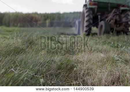 Abstract agriculture transport moving in the field with a pollution coming out shallow depth of field cropped shot