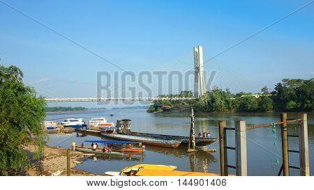 Puerto Francisco de Orellana, Orellana / Ecuador - January 16 2016: View of the bridge of El Coca on the Napo River. This bridge is the most important infrastructure project of the town