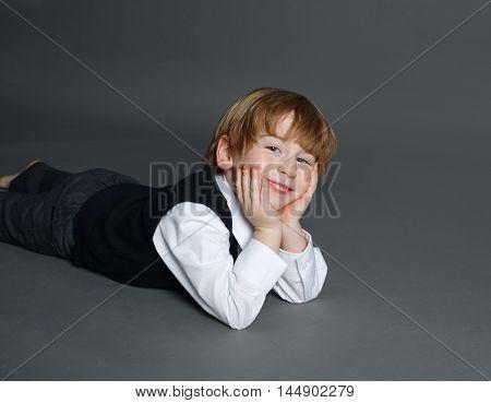 photo of little funny boy on dark background