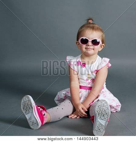 photo of cute little girl with sunglasses