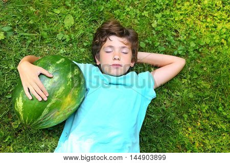 preteen handsome boy with water melon close up portrait