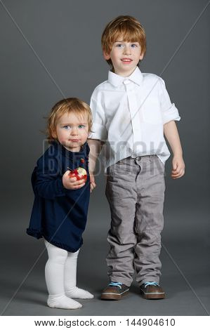 photo of funny boy and girl on grey