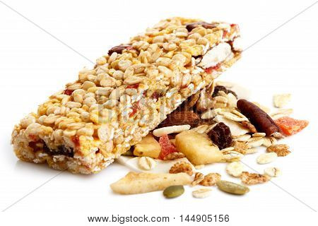 Muesli Bar On Heap Of Fruit, Seeds And Nuts.