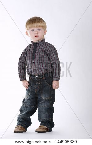 photo of little funny boy posing on white background