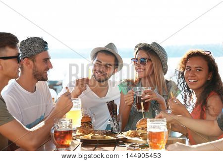 Group of friends hanging out together outdoors