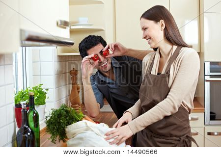 Man Holding Tomatoes In Kitchen