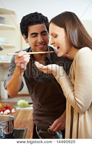 Man Letting Woman Taste Soup
