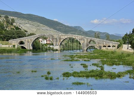 Arslanagica Most over Trebisnjica River in Trebinje Bosnia also known since 1993 as Perovica Bridge. Built by Ottomans in 1574 it was moved and physically rebuilt in 1970 a few kilometres from its original location.