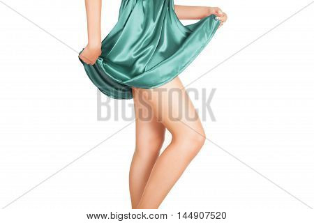 Legs Of Beautiful Model Covered With Short Pretty Skirt.