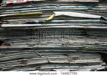 Stack of old abandoned magazines closeup cropped shot
