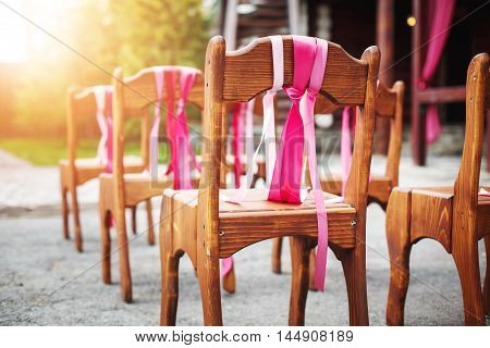 Beautiful Wooden Chairs Decorated With Ribbons