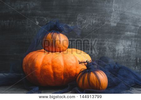 composition of the three pumpkins and blue tulle