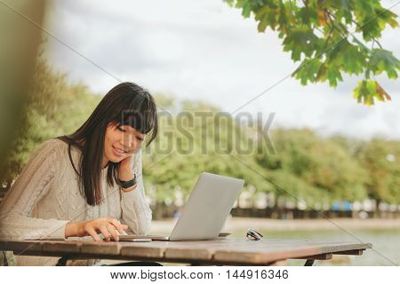 Happy Woman Using Smartphone At Coffee Shop