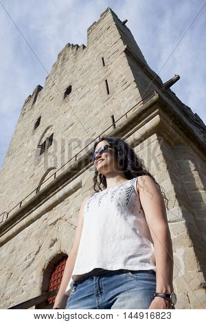Tourist Girl In Front Of A Tower In Carcassonne City