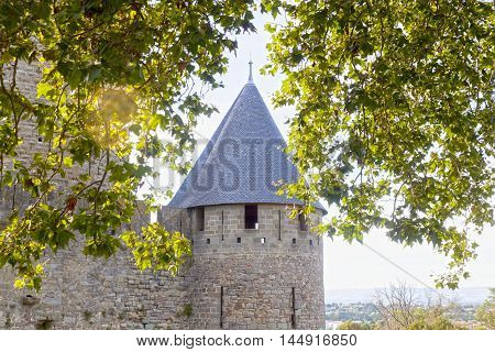 Tower Of Carcassonne City With Some Trees In Front Of It