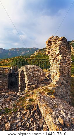 Landscape of the ruins of the fortress at sunset. (Funa)