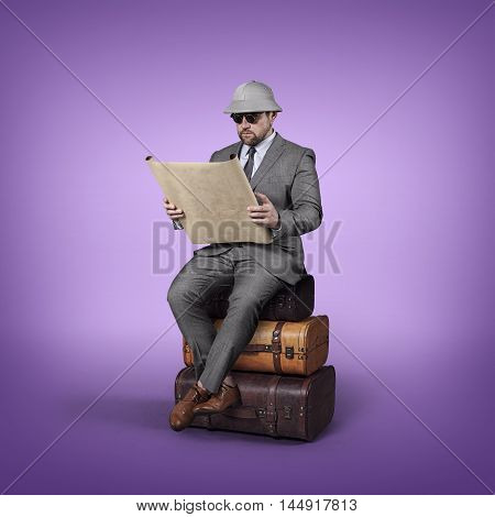 Explorer businessman lost in office and reading map with suitcases