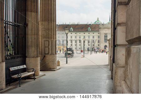 VIENNA, AUSTRIA - JUN 10, 2016: Stone columns and crowd of the tourists in historic centre of Vienna UNESCO World Heritage Site on June 10, 2016. Vienna city has population near 1.8 million