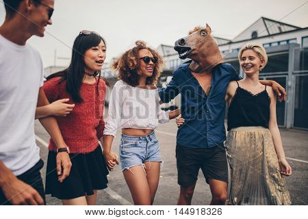 Diverse Group Of Friends Having Fun Outdoors