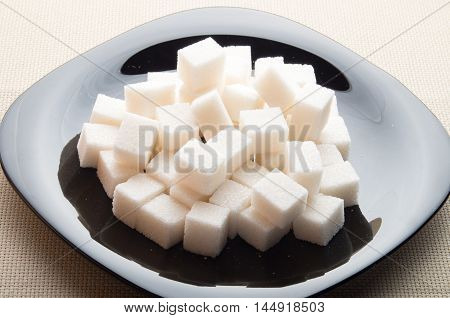 Pieces Of Sugar On A Black Plate With Backlight