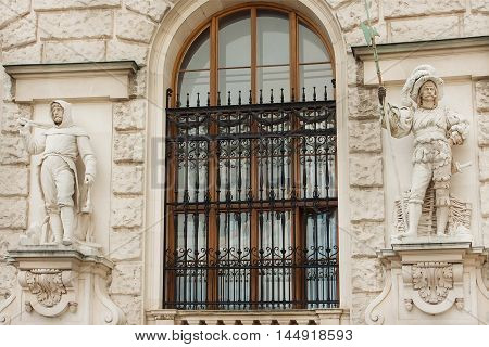 VIENNA, AUSTRIA - JUN 10, 2016: Stone guard and soldier sculpture on relief of historical building of center Vienna UNESCO World Heritage Site on June 10, 2016. Vienna city has population near 1.8 million