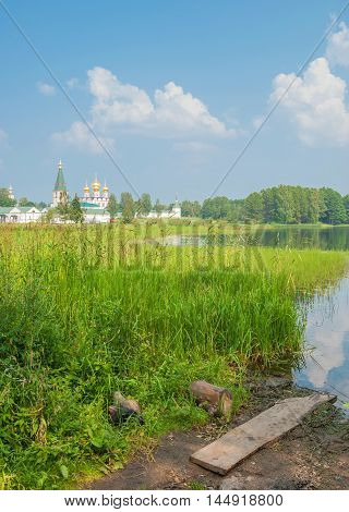 Russian landscape with a lake and a monastery on the banks