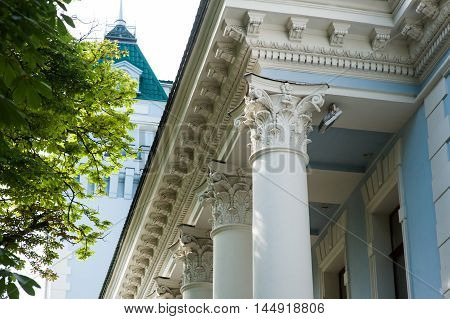 white columns on the facade of the building in classical style.