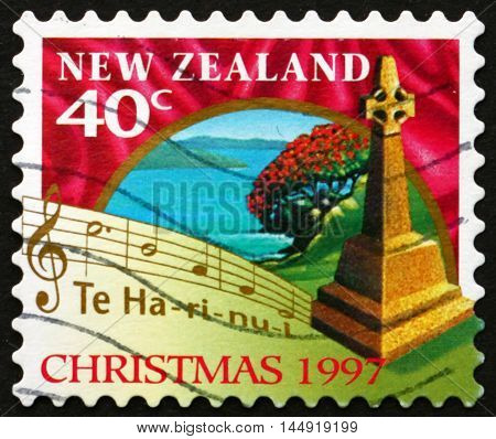 NEW ZEALAND - CIRCA 1997: a stamp printed in New Zealand shows Cross Marking Spot of First Christian Service Rangihoua Bay and Words from Christmas Carol circa 1997