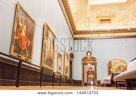 VIENNA, AUSTRIA - JUNE 10, 2016: Hall with carved ceilings and big collection of masterpiece paintings of Kunsthistorisches Museum on June 10, 2016. Musem of Art History was opened in 1891.