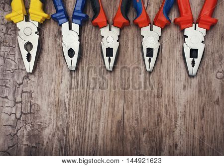 copyspace image set of handtools  pliers  on vintage wooden board construction concept