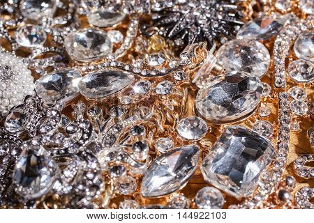 Close up of luxury precious golden and silver jewelry background
