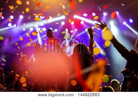 Confetti Falling Over The Crowd