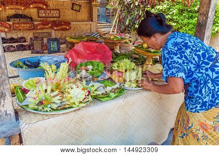 Ubud, Indonesia - August 29, 2008: Woman Preparing Traditional Sacred Fruits For Ritual