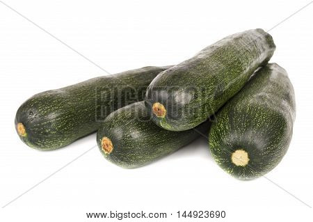 close up of green marrows isolated over white