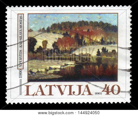 Latvia - CIRCA 2001: A stamp printed in  Latvia shows when the forest wakes, painting by Vilhelms Purvitis, circa 2001