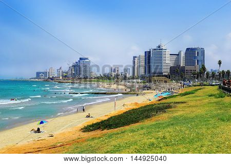 TEL AVIV, ISRAEL - August 24, 2016: view of the waterfront with modern luxury hotels and beach from old Jaffa on august 24, 2016 Tel Aviv, Israel