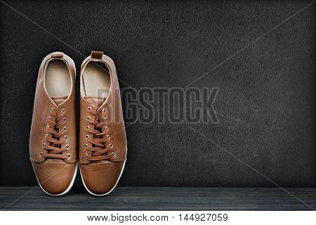 text on black board and shoes