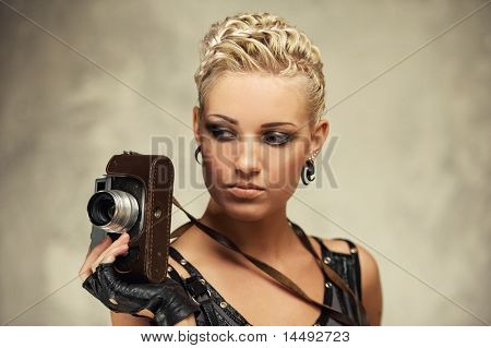 Close-up portrait of a steam punk girl with a photocamera