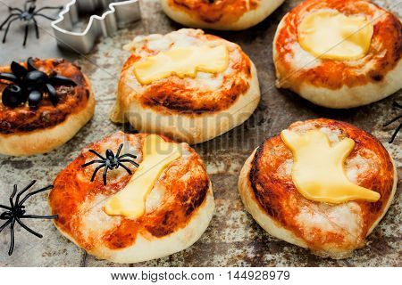 Halloween food and snack ideas - mini pizzas with tomato sauce and cheese selective focus